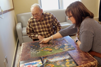 man and woman doing a puzzle